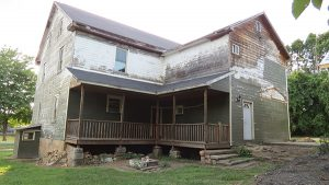 The Beuter house exterior is being cleaned up by Zoar Community Association.